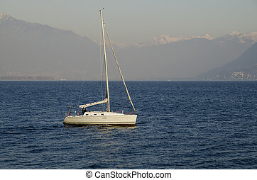 Sailing boat on a misty lake