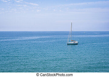 Sailing boat on blue mediterranean sea water