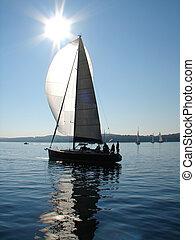 Sailing boat on calm sea - Sailing on calm sea with sun...