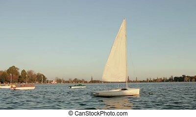 sailing boat rocking on the lake