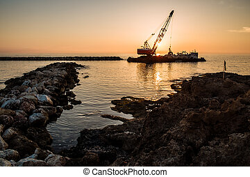 sailing boat sunset at beach in Cyprus