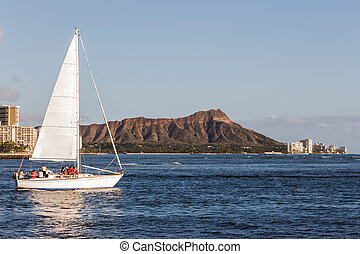 Sailing boat with Diamond head mountain background, Oahu...