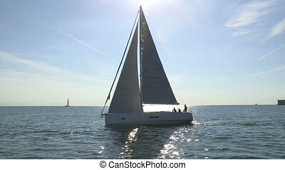 Sailing boat with open sails