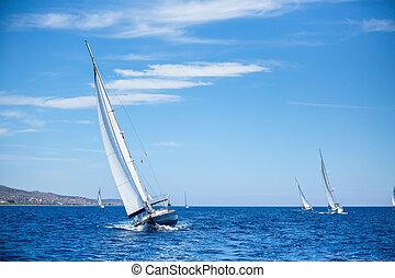 Sailing boats during a sea race. Yacht. Sailing. Yachting. ...