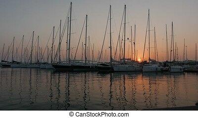 Sailing boats in marina at a sunset 4k.