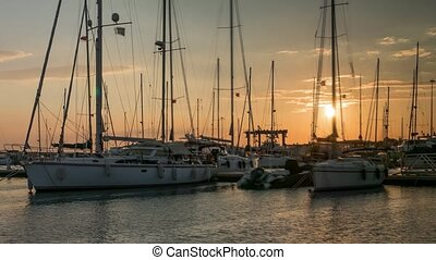 Sailing boats in marina at sanset with ducks. Time lapse, 4k.