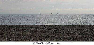 Sailing boats on the horizon
