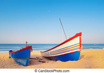 Sailing Boats - Two sailing boats on the sandy beach