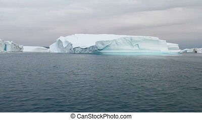 Sailing by an iceberg