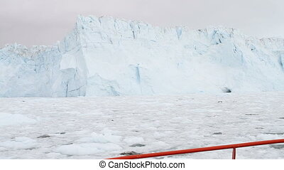 Sailing by the Eqi glacier