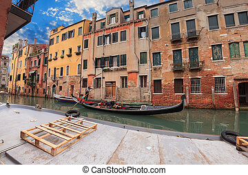 Sailing gondola in Venice near pier