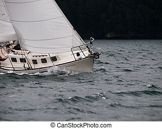Sailing in a storm - Healed over during a winter sail race...