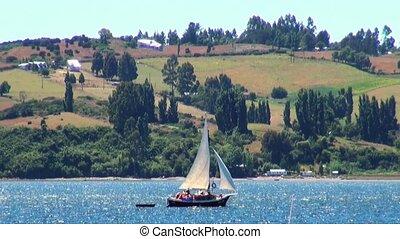 Sailing in Castrobay on Chilo? Island. Castro is a city on Chilo? Island in Chile's Lake District. 11th of January 2014 - Castro Chile, South America