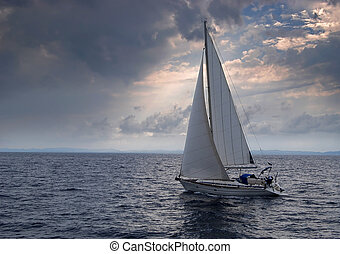 Sailing boat heading into a storm