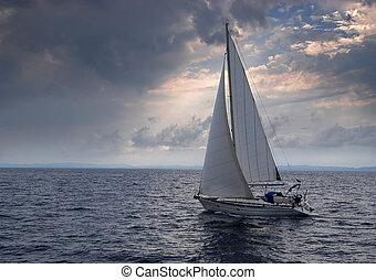 Sailing into a storm - Sailing boat heading into a storm