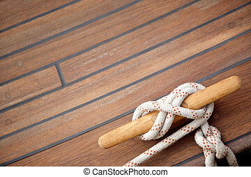 Sailing knot on a wooden floor - Tied up with a knot in a...