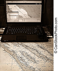 Sailing navigation. Traditional map and modern computer based gps system.