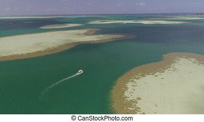 Sailing on great barrier reef - An aerial shot of a boat in...