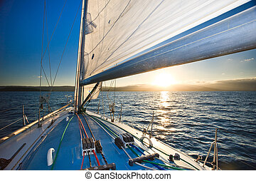 Sailing on the ocean at sunset
