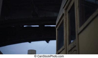 Sailing on the ship under a bridge at dusk