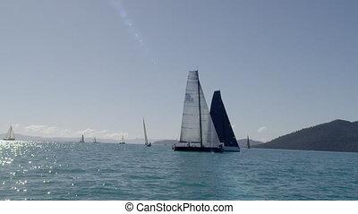Sailing past sailboats