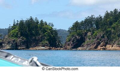 Sailing past small islands
