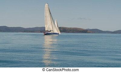 Sailing past two sailboats