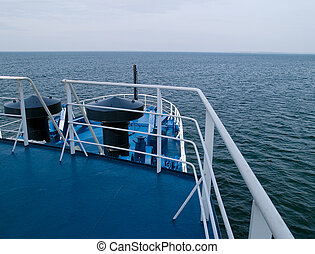 Sailing! Prow of a boat sailing in deep sea waters