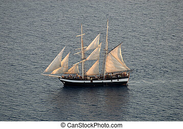 Sailing ship in the Aegean Sea near Santorini, Greece