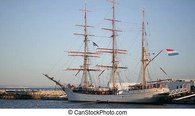 Sailing ship in the bay in cascais marina, coastline of atlantic ocean in portugal