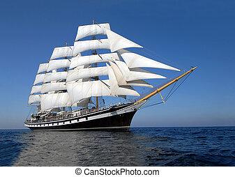 Sailing ship in the blue ocean