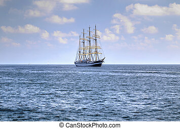 Sailing ship in the blue sea