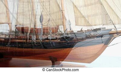 Model historic sailing ship. Dolly shot moving