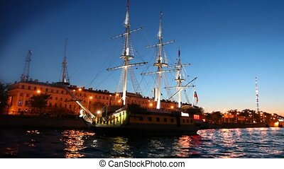 Sailing ship standing at pier on night Neva river