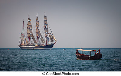 Sailing ship and boat in the sea