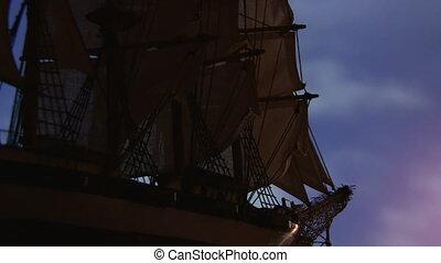 Sailing ship - Large old sailing ship travels at night....