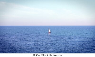 Sailing ship yacht with white sails at the open sea -...