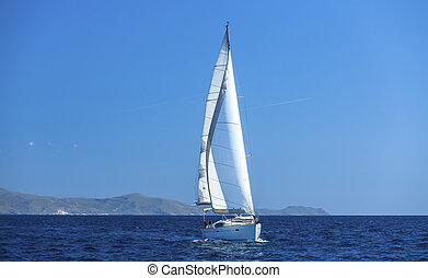 Sailing ship yachts with white sails. Luxery sailing yacht.