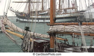 Sailing ships in a hail storm