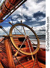 Sailing - Helm and deck view on a schooner.