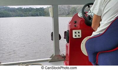 Sailing through the river. Capitan is driving the cruiser.