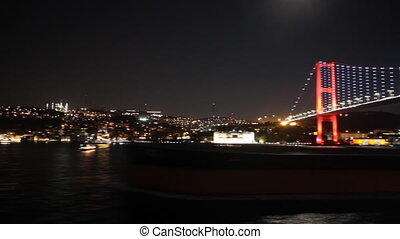 Sailing under Istanbul's bridge at night