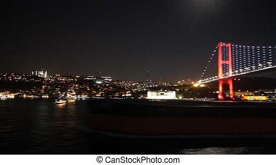 Sailing under Istanbul's bridge at night
