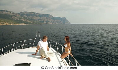 Couple enjoying their bay cruise on motor boat