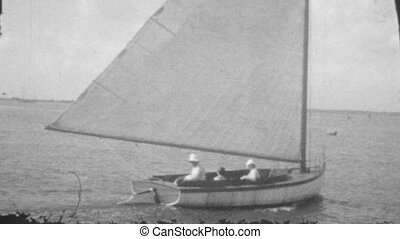 Sailing. (Vintage 1930s 16mm film) - Sailing on a single...