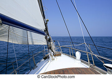 Sailing with an old sailboat over mediterranean sea