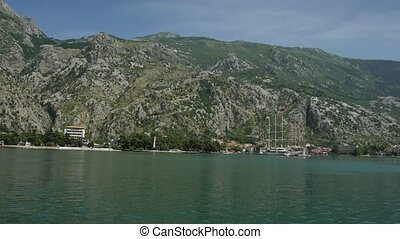 Sailing wooden ship on the docks in Kotor. Water transport. Mont