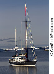 sailing yacht at anchor in the waters of the Antarctic summer da