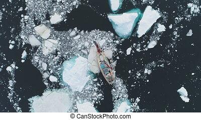 Sailing yacht break through antarctic melting ice - Sailing...
