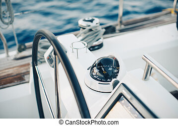 Sailing yacht control cockpit, wheel and implement. ...